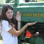 Girl beside tractor 8.2011