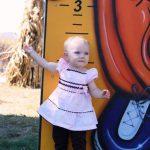 baby at pumpkin ruler