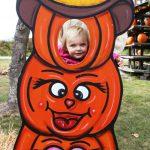 little girl at pumpkin peek a boo